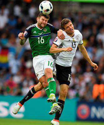 PARIS, FRANCE - JUNE 21: Oliver Norwood (L) of Northern Ireland and Thomas Muller (R) of Germany during the UEFA EURO 2016 Group C match between Northern Ireland and Germany at Parc des Princes on June 21, 2016 in Paris, France. (Photo by Charles McQuillan/Getty Images)