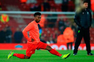 Daniel Sturridge of Liverpool stretches during the warm up prior to kick off during the EFL Cup fourth round match between Liverpool and Tottenham Hotspur at Anfield on October 25, 2016 in Liverpool, England.  (Photo by Jan Kruger/Getty Images)