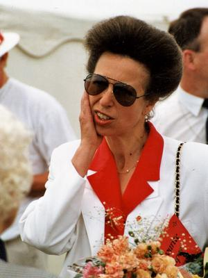'Her Royal Highness the Princess Royal visits Wakefield's Citizens Advice Bureaux and left holding a plastic bag, July 1989 (left); and Princess Anne visits a Save the Children Gala at Pontefract Racecourse, July 1994 (right)