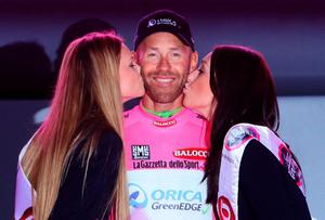 Svein Tuft celebrates after Orica GreenEDGE won the Team Time Trial and he won the pink jersey after the opening stage the of the 2014 Giro D'Italia in Belfast