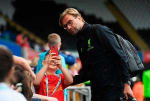 Jurgen Klopp, manager of Liverpool takes a selfie photograph with a fan while arriving at the stadium prior to kick off during the Premier League match between Swansea City and Liverpool at Liberty Stadium on October 1, 2016 in Swansea, Wales.  (Photo by Stu Forster/Getty Images)