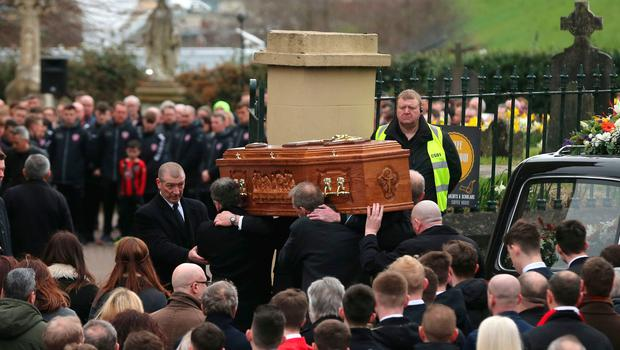 The coffin of Derry City football captain Ryan McBride is carried into the Long Tower church in Londonderry, he was found dead at home on Sunday night aged 27. Niall Carson/PA Wire