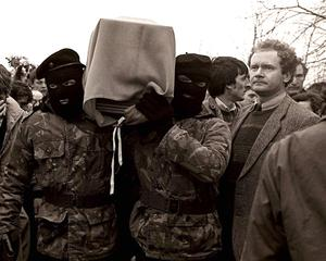 PACEMAKER BELFAST 19/11/99 Sinn Fein vice President Martin McGuinness pictured with masked IRA men at the funeral of Brendan Burns 5/3/88