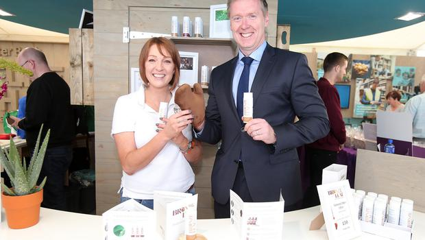 Press Eye - Belfast - Northern Ireland - 18th May 2018  Third day of the 2018 Balmoral Show, in partnership with Ulster Bank, at Balmoral Park.  Karen Walker from Bronze Leaf pictured with Mark Crimmins Regional Director Business Banking at Ulster Bank.    Bronze Leaf was one of the companies provided with free space by Ulster Bank to exhibit in its marquee. The companies include Ulster Bank customers and entrepreneurs from the bank's Entrepreneur Accelerator.  Picture by Jonathan Porter/PressEye
