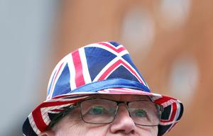 PACEMAKER, BELFAST, 13/7/2020: Jim Taggart sports a Union Jack hat and tie as he watches the bands parade on the Shankill Road, Belfast today. The Orange Order did not take part in their traditional Twelfth of July processions this year because of the restrictions around Coronavirus but there were band parades around local areas across Northern Ireland. PICTURE BY STEPHEN DAVISON