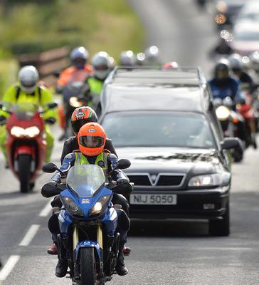 Pacemaker Press 7/7/2015 Dr Fred MacSorley and Dr John's Partner (Janet) leads the Cortege , As Motorcyclists pay tribute to the late road racing doctor John Hinds on Tuesday by riding with his cortege during a lap of the Tandragee 100 course, Which was his favourite  road racing circuit  . The well-known ?flying doctor? died on Saturday following a crash during a practice session at the Skerries 100 in the Republic of Ireland.  Dr Hinds was a intensive care consultant and anaesthetist at Craigavon Hospital in Co Armagh but frequently attended road races to provide medical cover. Pic Colm Lenaghan/Pacemaker