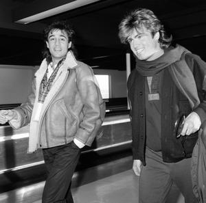 George Michael and Andrew Ridgeley of Wham at Heathrow Airport before leaving for a tour of Japan. 05/01/85