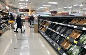 Depleted shelves in Sainsbury's at the Forestside shopping centre in Belfast (David Young/PA)