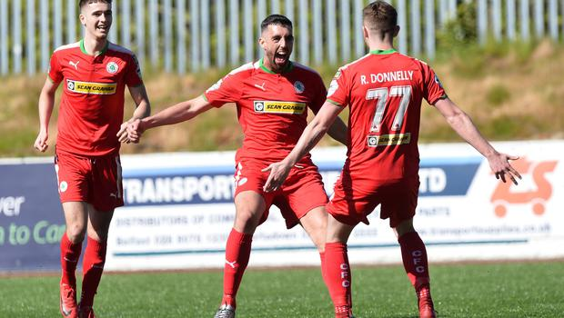 PACEMAKER BELFAST   12/05/2018 Cliftonville v Glentoran Europa league Play Off CliftonvilleÕs Rory Donnelly scores to make it 2-0   during this afternoons game at Solitude in Belfast. Photo Colm Lenaghan/Pacemaker Press