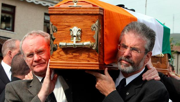 File photo dated 24/05/08 of Sinn Fein President Gerry Adams (right) and Martin McGuinness carrying the coffin of former senior IRA commander Brian Keenan in west Belfast.  Paul Faith/PA Wire