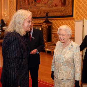 Queen Elizabeth II meets Billy Connolly at a reception for the British Film Industry at Windsor Castle