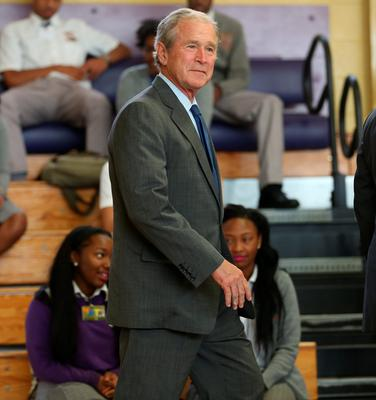 Former president George W Bush attends an event at Warren Easton High School in New Orleans to mark the 10th anniversary of Hurricane Katrina