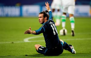 Real Madrid's Welsh forward Gareth Bale raects during the UEFA Champions League quarter-final, first-leg football match between VfL Wolfsburg and Real Madrid on April 6, 2016 in Wolfsburg, northern Germany.  / AFP PHOTO / Ronny HartmannRONNY HARTMANN/AFP/Getty Images