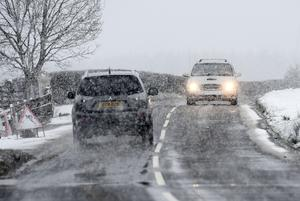 Drivers battle through the snow on the outskirts of Armoy in Northern Ireland. Photo Colm Lenaghan/Pacemaker Press