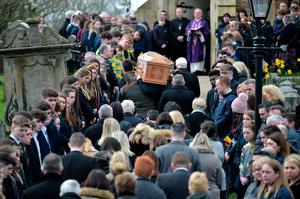 Mourners attend the funeral of Connor Currie. (Photo by Charles McQuillan/Getty Images)