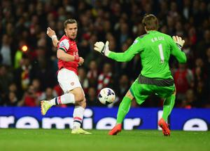 LONDON, ENGLAND - APRIL 28:  Lukas Podolski of Arsenal is faced by goalkeeper Tim Krul of Newcastle United during the Barclays Premier League match between Arsenal and Newcastle United at Emirates Stadium on April 28, 2014 in London, England.  (Photo by Jamie McDonald/Getty Images)