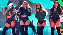 Jesy Nelson (far right) promised on Instagram that Little Mix would dedicate a song at their Belfast show.