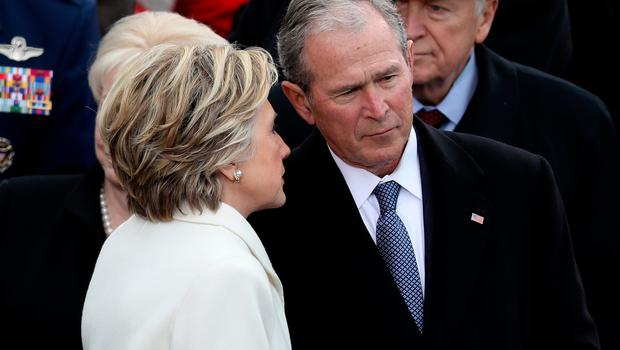 Former Democratic presidential nominee Hillary Clinton whispers to former President George W. Bush  on the West Front of the U.S. Capitol on January 20, 2017 in Washington, DC. In today's inauguration ceremony Donald J. Trump becomes the 45th president of the United States.  (Photo by Joe Raedle/Getty Images)