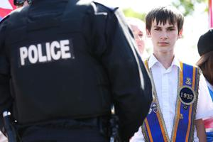 Press Eye - Belfast -  Saturday 20th July 2013   Orange supporters pictured at the Twadell Avenue interface in Belfast afternoon attempt to parade up to the police lines.  In an unexpected move earlier this week, Orangemen made a new application to the Parades Commission adjudication body to march the disputed Crumlin Road section of the route today. That bid was again rejected by the commission - a move that is likely to prompt another stand-off between police and protesters at the same community interface area later.  The Order said it applied for Saturday's event to complete a return parade they were banned from making on the Twelfth of July.  Order members have continued to hold protests in the area throughout the week.  Picture by Kelvin Boyes / Press Eye.