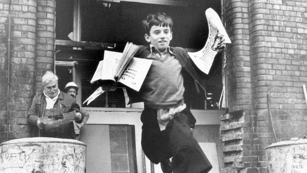 No stopping the 'Tele' from hitting the streets, despite having been rocked by an explosion.  Here newsboy Joe Officer makes his way through the rubble to sell Belfast Telegraph's.