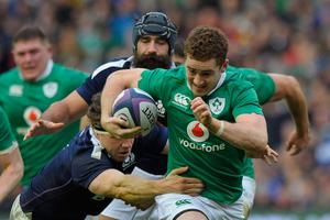 Ireland's fly-half Paddy Jackson (R) is tackled by Scotland's flanker Hamish Watson during the Six Nations international rugby union match between Scotland and Ireland at Murrayfield in Edinburgh, Scotland on Febuary 4, 2017.   AFP/Getty Images
