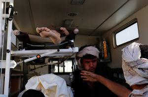 Bodies of victims of a Saudi-led coalition airstrike are loaded in an ambulance, in Sanaa, Yemen, Saturday, Oct. 8, 2016. Yemeni security and medical officials say at least 45 people have been killed in a Saudi-led coalition airstrike that targeted a funeral hall in the capital, Sanaa. The officials say at least another 100 have been wounded in the Saturday strike. (AP Photo/Osamah Abdulrhman)