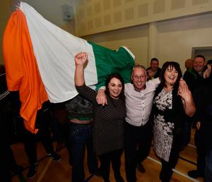 OMAGH, NORTHERN IRELAND - MARCH 03: Sinn Fein's Michelle Gildernew (R), Sean Lynch (C) and Jemma Dolan (L) celebrate winning their three seats in the Fermanagh South Tyrone election as the Northern Ireland Stormont election count takes place on March 3, 2017 in Omagh, Northern Ireland. Voters went to the polls for the second time in 10 months after the collapse of the power sharing executive government. (Photo by Charles McQuillan/Getty Images)