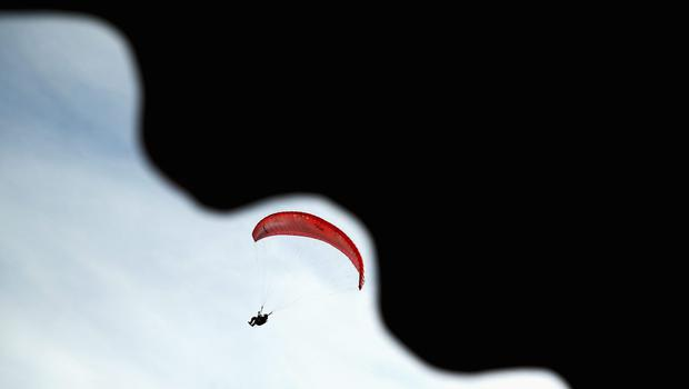 An athlete competes in the Air Sports Paragliding Men's Individual Accuracy during the 2014 Asian Beach Games at Chaofa Mine on November 17, 2014 in Phuket, Thailand.  (Photo by Cameron Spencer/Getty Images)