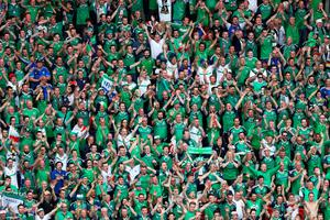 PARIS, FRANCE - JUNE 21:  Northern Ireland supporters cheer for their team after the UEFA EURO 2016 Group C match between Northern Ireland and Germany at Parc des Princes on June 21, 2016 in Paris, France.  (Photo by Paul Gilham/Getty Images)