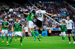PARIS, FRANCE - JUNE 21:  Mario Gomez of Germany heads the ball during the UEFA EURO 2016 Group C match between Northern Ireland and Germany at Parc des Princes on June 21, 2016 in Paris, France.  (Photo by Shaun Botterill/Getty Images)