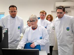 Taoiseach Leo Varadkar (left), Minister for Health Simon Harris (right)and Director, Dr. Cillian De Gascun  (centre) of UCD National Virus Reference Laboratory, University College Dublin, Belfield, Dublin, watch a technician during a visit to the laboratory. Photo credit: Aidan Crawley/PA Wire