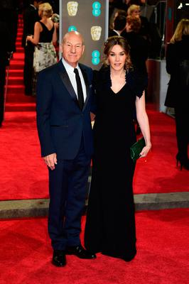 Patrick Stewart and Sunny Ozell attending the EE British Academy Film Awards held at the Royal Albert Hall, Kensington Gore, Kensington, London.  PRESS ASSOCIATION Photo. Picture date: Sunday February 18, 2018. See PA Story SHOWBIZ Bafta. Photo credit should read: Ian West/PA Wire.