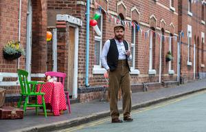 A resident of Cambrian Road in Chester dresses up in 1945 clothing to join in a social distancing tea party to mark the 75th anniversary of VE Day. PA Photo. Picture date: Friday May 8, 2020. Although large-scale public events are unable to go ahead because of coronavirus retrictions, tributes will be paid by politicians and members of the royal family, as well as through a host of other events as the nation remembers those who fought and died in the Second World War. Photo credit should read: Peter Byrne/PA Wire
