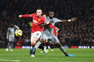 Manchester United's Wayne Rooney (left) and Newcastle United's Moussa Sissoko (right) battle for the ball during the Barclays Premier League match at Old Trafford, Manchester. Rickett/PA Wire.