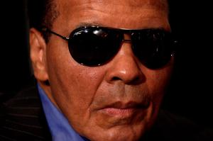 This file photo taken on May 24, 2011 shows shows World Heavyweight Boxing Champion Muhammad Ali at a news conference at the National Press Club in Washington. Boxing legend Muhammad Ali, dies at 74. The former heavyweight world champion was hospitalized on Thursday at a Phoenix, Arizona, hospital with a respiratory issue, which US media reported was complicated by his Parkinson's disease.  / AFP PHOTO / YURI GRIPASYURI GRIPAS/AFP/Getty Images
