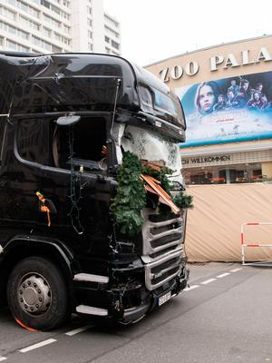 A truck is towed away from the Christmas market at Breitscheidplatz square in Berlin, Germany, Tuesday Dec. 20, 2016. The truck ran into a crowded Christmas market in Berlin the evening before and killed several people. ( Bernd von Jutrczenka/dpa via AP)