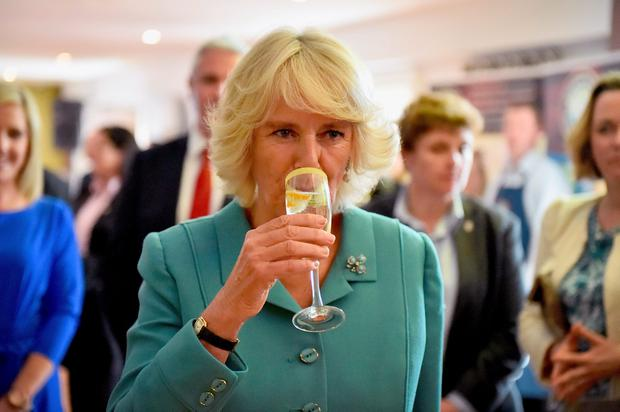 """Britain's Camilla, Duchess of Cornwall samples a cocktail, called """"The Duchess"""" as she visits the Taste of the Wild Atlantic Way Food Festival at the House Hotel in Galway, west Ireland on May 19, 2015. Prince Charles became the first British royal to meet Irish republican leader Gerry Adams, on a visit that will take him to the scene of his great-uncle's murder by the IRA.  AFP PHOTO / POOL / JEFF J MITCHELLJEFF J MITCHELL/AFP/Getty Images"""