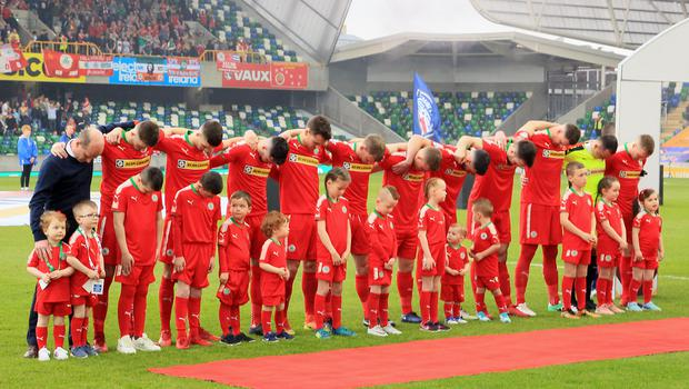 Cliftonville players bow their heads in protest as God Save The Queen was played at the Irish Cup Final at Windsor Park last Saturday