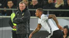 Eye on the ball: Northern Ireland boss Michael O'Neill watches on in Hannover last night, as Germany's Jerome Boateng keeps possession