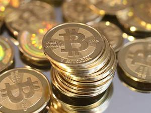 Bitcoin is an experimental digital currency that has gained popularity worldwide (Getty)