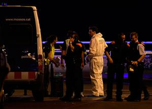 Policemen check the area after police killed five attackers in Cambrils near Tarragona on August 18, 2017. Drivers have ploughed into pedestrians in two quick-succession, separate attacks in Barcelona and another popular Spanish seaside city, leaving 13 people dead and injuring more than 100 others. The incident in Cambrils injured six civilians -- one of them critical -- and a police officer, authorities said.  / AFP PHOTO / LLUIS GENELLUIS GENE/AFP/Getty Images