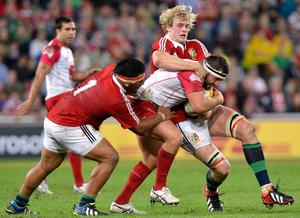 BRISBANE, AUSTRALIA - JUNE 08:  James Hanson of the Reds attempts to push through the defence during the match between the Queensland Reds and the British & Irish Lions at Suncorp Stadium on June 8, 2013 in Brisbane, Australia.  (Photo by Bradley Kanaris/Getty Images)