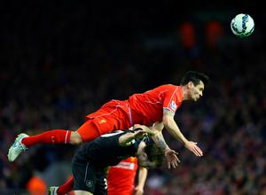 LIVERPOOL, ENGLAND - MARCH 04:  Dejan Lovren of Liverpool climbs to win the ball during the Barclays Premier League match between Liverpool and Burnley at Anfield on March 4, 2015 in Liverpool, England.  (Photo by Michael Steele/Getty Images)