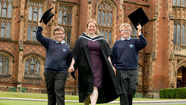 Pictured celebrating graduation success is Julie McVeigh with two of her sons, Peter and Aaron, who is graduating with a degree in Law, from the School of Law at Queen's University Belfast.