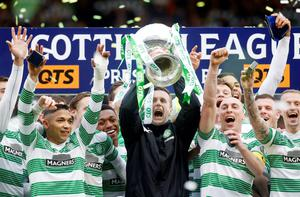 Just champion: Ronny Deila lifts the League Cup at Hampden Park