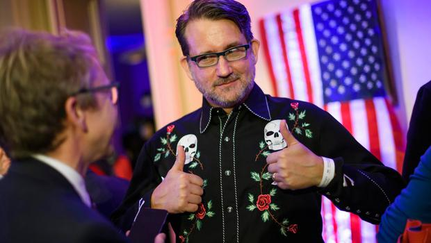A man wearing a shirt adorned with skulls gives thumbs up during the US Election Night Celebrations in Switzerland in Geneva, on November 8, 2016. America's future hung in the balance on November 8, 2016 as millions of eager voters cast ballots to elect Democrat Hillary Clinton as their first woman president, or hand power to the billionaire populist Donald Trump. / AFP PHOTO / FABRICE COFFRINIFABRICE COFFRINI/AFP/Getty Images