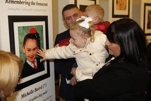 21/10/18 PACEMAKER PRESS An exhibition was opened to commerate the victims of the Shankill Bombing in the Methodist Church on the shankill Road. Isla McKee touches a picture of her relative Michelle Baird. PICTURE MATT BOHILL PACEMAKER PRESS