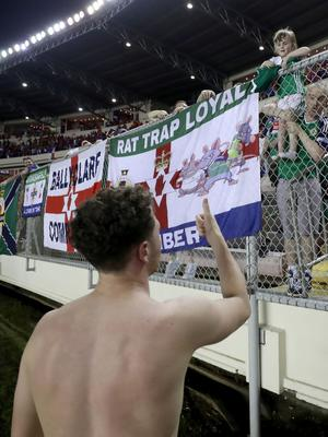 Press Eye - Belfast -  Northern Ireland - 29th May 2018 - Photo by William Cherry/Presseye  Northern Ireland's Corry Evans gives his shirt away to a young fan at the final whistle of Wednesday nights International Friendly against Panama at the Estadio Rommel Fernandez, Panama City.