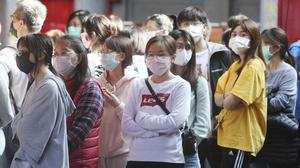People wearing face masks to protect against the spread of the coronavirus
