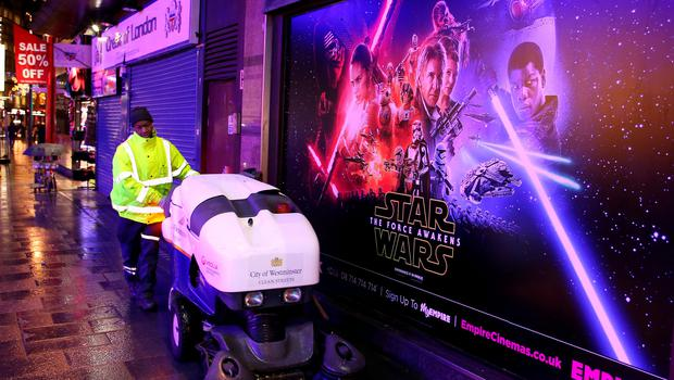 """LONDON, ENGLAND - DECEMBER 15:  Preperations for the """"Star Wars: The Force Awakens"""" European premiere in Leicester Square on December 15, 2015 in London, England. The film, starring members of the original cast including Harrison Ford, Mark Hamill and Carrie Fisher, is the seventh film in the Star Wars franchise and is directed by J.J. Abrams.  (Photo by Mark Robert Milan/Getty Images)"""